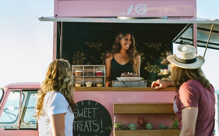 Woman selling cupcakes from a food truck