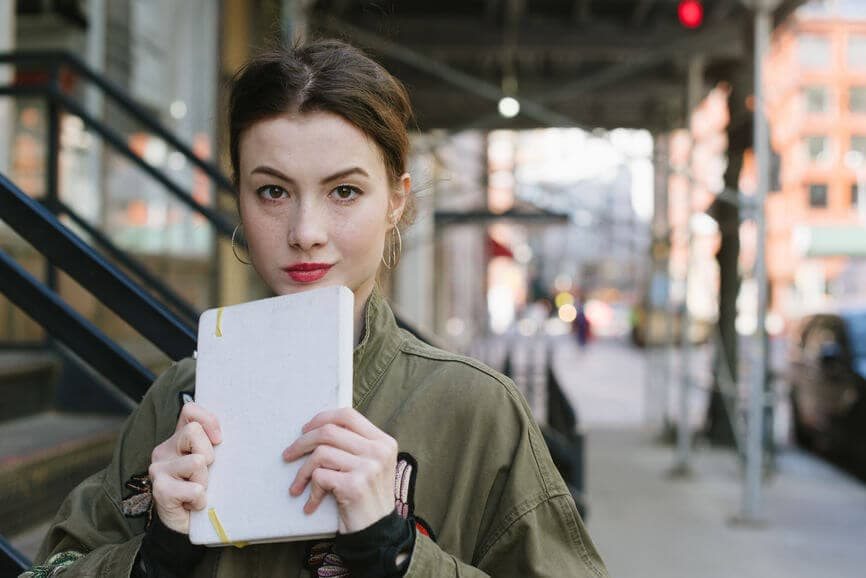millennial woman with a notepad