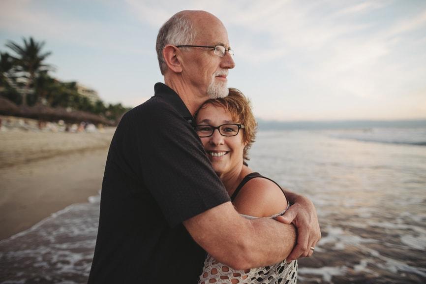 Senior couple hugging on the beach