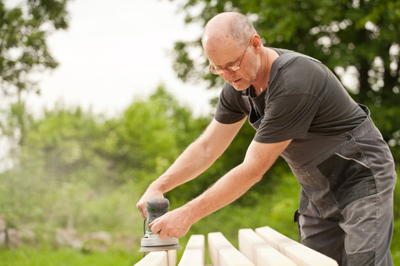 Taskrabbit Tasker sanding wood