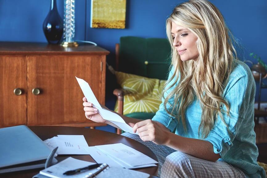 Young woman reviewing her financial and tax documents.