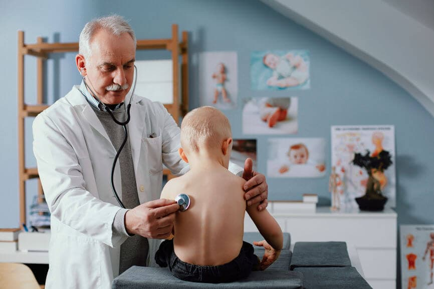doctor checking a child's heartbeat