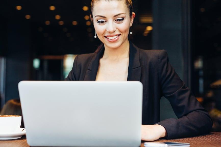 Professional business woman using laptop