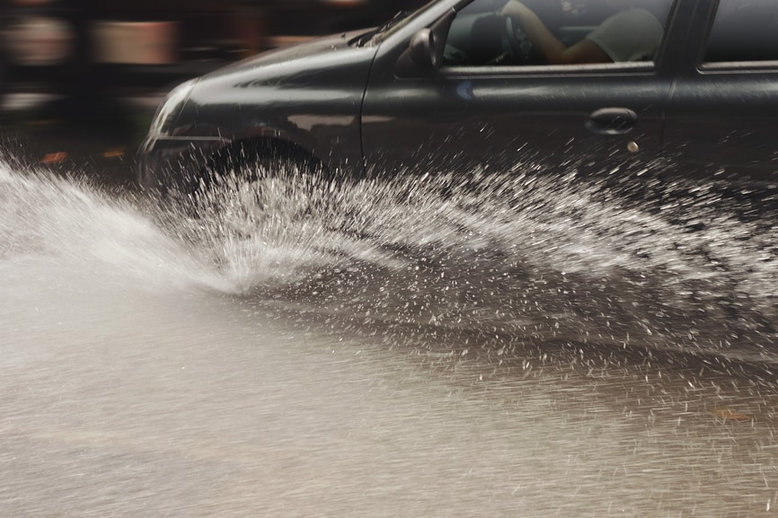 Car driving through flooded area
