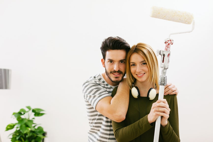 Couple painting the house