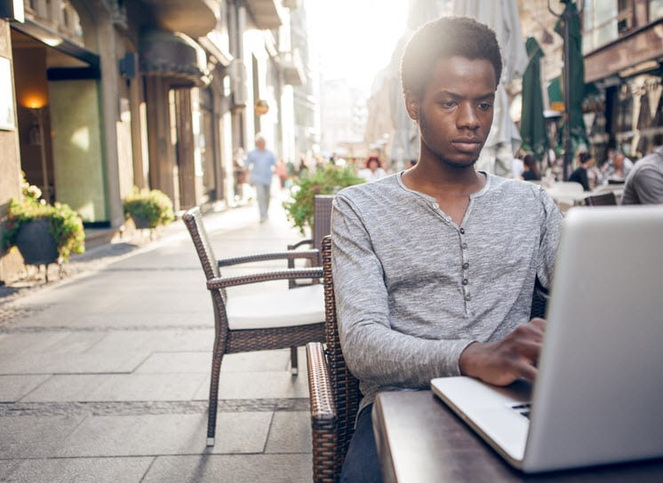 African American Man using laptop