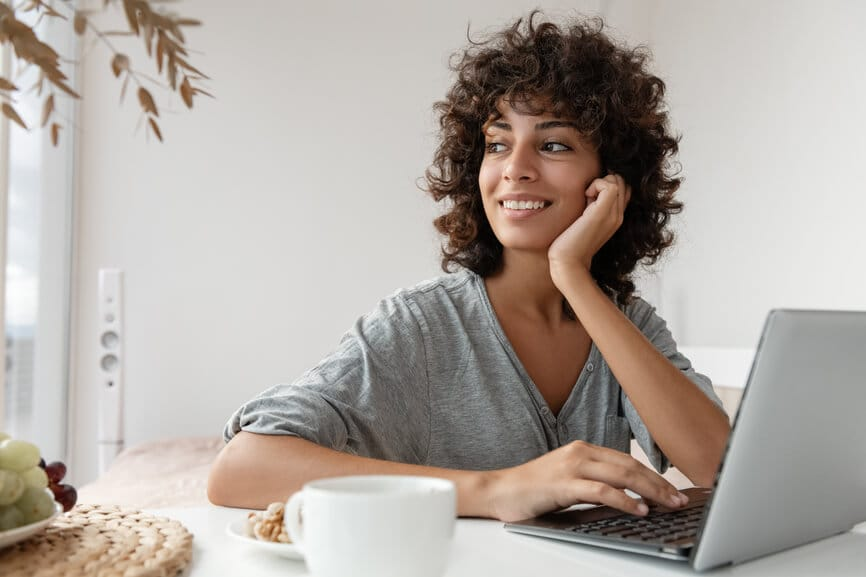 Smiling woman working on her laptop.