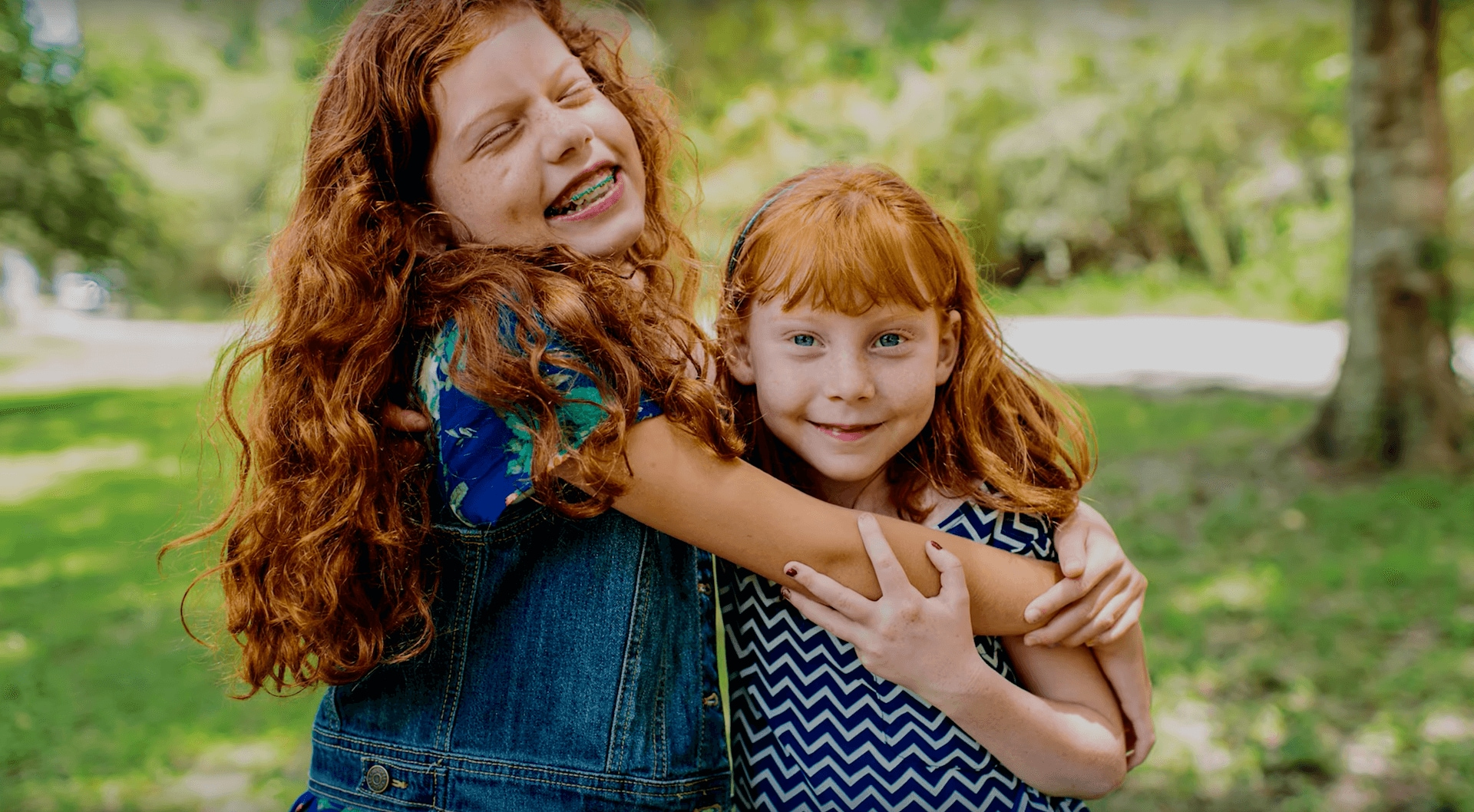 two smiling children hugging each other
