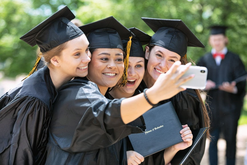 Multi-ethnic group college graduates taking a selfie