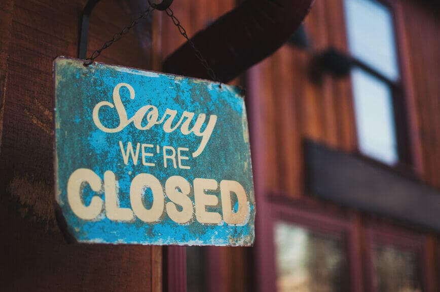 a closed sign outside of a shop
