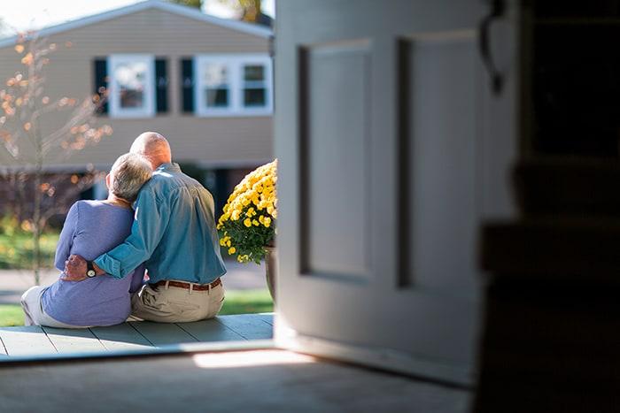 Senior couple sitting on the porch