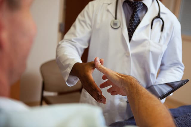 Doctor shaking the hand of a patient