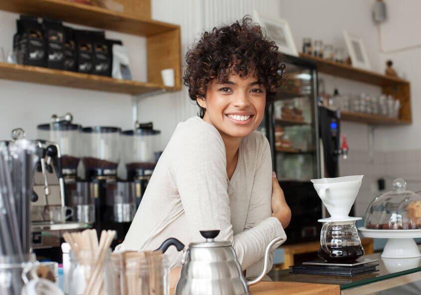portrait of a barista inside a modern coffee shop