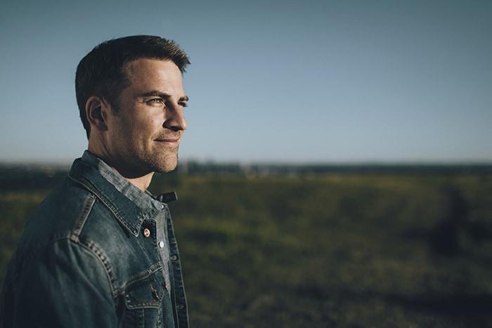 Man staring across a field