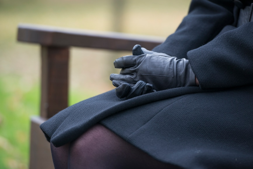 Woman in all black for funeral mourning